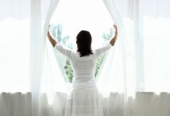 photo_of_woman_opening_curtains.jpg